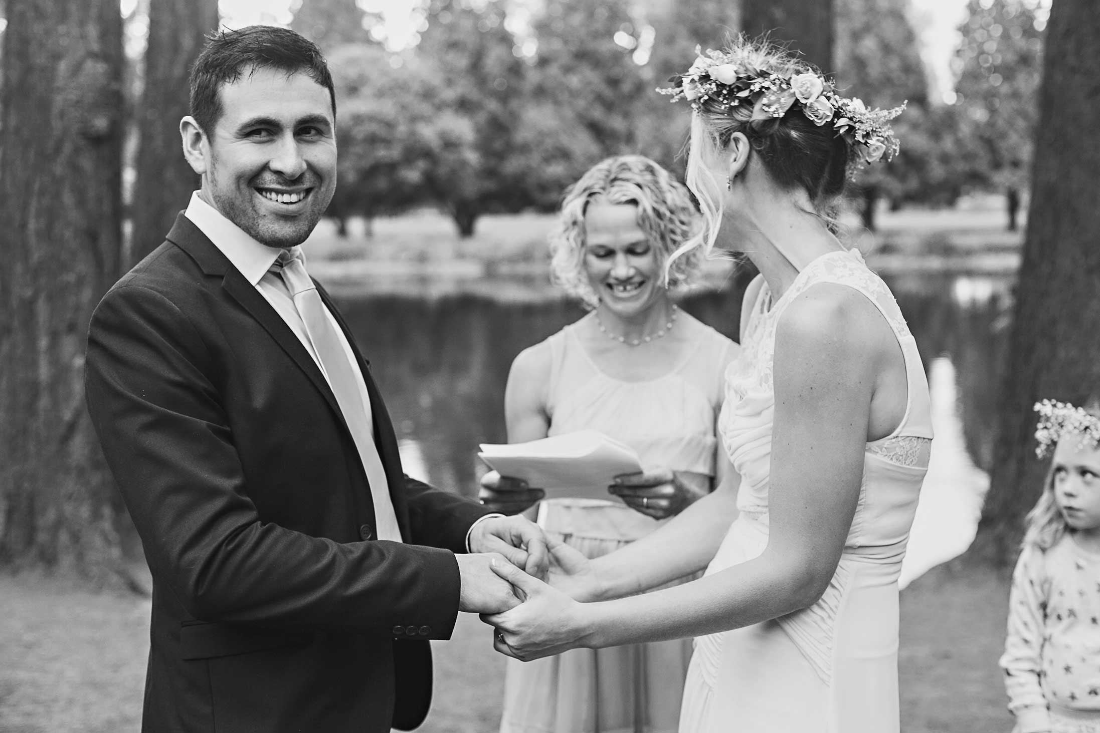 black-and-white-garden-wedding-groom-happy